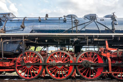 Side view on CSD, Czechoslovak steam locomotive, with huge, red spoke main wheels Stock Photos