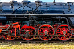 Side view on CSD, Czechoslovak steam locomotive, with huge, red spoke main wheels Royalty Free Stock Photo