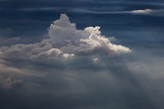 Side view of cumulus clouds and sunrays Stock Photography