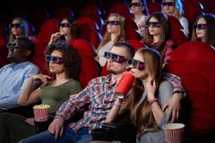 Side view of cute couple watching movie in 3d. stock photos