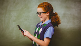 Side view of cute little girl holding calculator Stock Photo