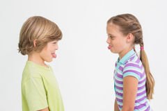 Side view of cute siblings teasing each other Stock Images