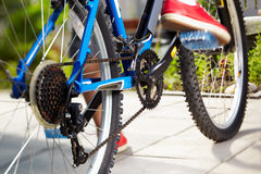 Side view of a cycle with front wheel Stock Photos