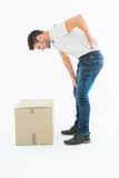 Side view of delivery man suffering from back pain Royalty Free Stock Image