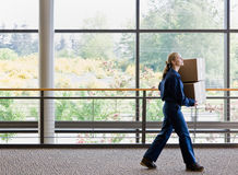 Side view of delivery woman in uniform Royalty Free Stock Photos