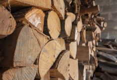 Side view of stacked firewood stock photos