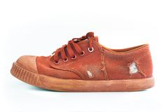 Side view of Dirty Used brown shoe on white background Stock Photos