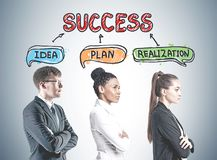 Side view of diverse business team members success. Profiles of diverse business team members against a gray wall with a success, idea, plan, realization sketch Royalty Free Stock Photography