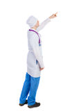 Side view of doctor in robe pointing. Stock Image