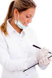 Side view of doctor with writing pad Royalty Free Stock Images