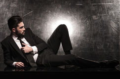 Side view of a dramatic business man on the floor Stock Photo