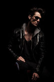 Side view of dramatic young man in leather jacket Stock Photography