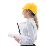 Side view of dreaming business woman architect in builder helmet Stock Images