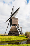 Side view Dutch windmill in autumn Royalty Free Stock Photography