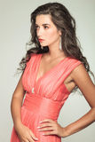 Side view of an elegant woman in red dress Stock Photos