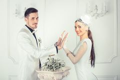 Content young bride and groom stacking hands stock photo