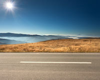 Side view of empty highway in mountain range Royalty Free Stock Photo