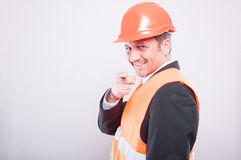 Side view of engineer wearing reflective vest pointing camera Stock Photos