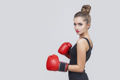 Side view of an exceptionally beautiful woman boxer stock images