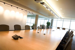Side view of executive boardroom in office. Side view landscape of executive boardroom in corporate modern day clean office Royalty Free Stock Images