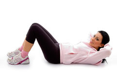 Side view of exercising female on white background Stock Image