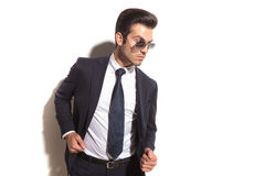 Side view of a fashion business man posing Royalty Free Stock Photo