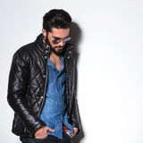 Side view of a fashion man in leather jacket Stock Photos