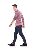 Side view of a fashion man walking Stock Image