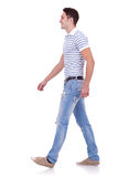 Side view of a fashion man walking forward Royalty Free Stock Image