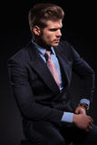 Side view of a fashion model in a classic suit and Royalty Free Stock Photography