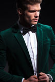 Side view of a fashion model in green velvet suit Royalty Free Stock Images
