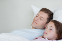 Side view of father and daughter asleep Royalty Free Stock Image