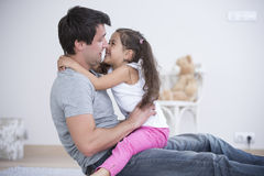 Side view of father and daughter spending quality time at home Royalty Free Stock Image
