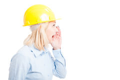 Side view female architect making shouting gesture Royalty Free Stock Photos