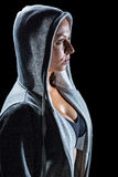 Side view of female athlete in hood Royalty Free Stock Photos