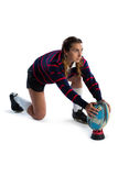 Side view of female athlete keeping rugby ball on tee Royalty Free Stock Image