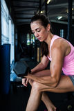 Side view of female athlete lifting dumbbell Stock Images