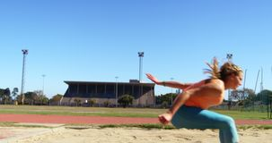 Female athlete practicing long jump at sports venue 4k stock footage