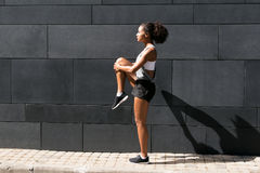 Side view of female athlete Stock Images