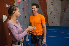 Female athlete talking to male trainer at health club Stock Photography