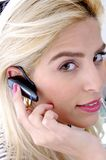Side view of female with bluetooth device Stock Photography