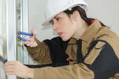 Side view female construction worker Royalty Free Stock Photography