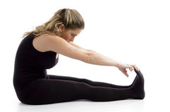 Side view of female doing exercise Stock Photography