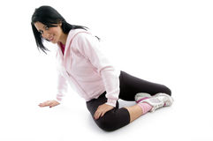 Side view of female doing exercise Royalty Free Stock Images
