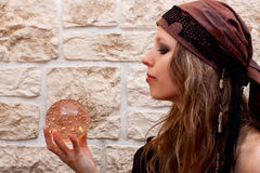 Side view of a female fortune teller Stock Photos