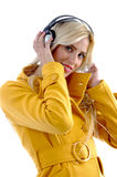 Side view of female holding headphone Royalty Free Stock Photography