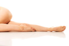 Side view of female legs and buttocks.  Stock Images
