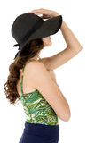 Side-view of female model in sunhat and swimsuit Royalty Free Stock Photo