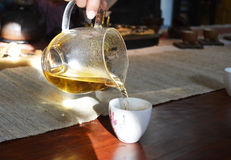 Side view of a female pouring tea Stock Photo