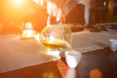 Side view of a female pouring tea Royalty Free Stock Image